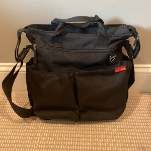 Skip Hop brand black diaper bag.